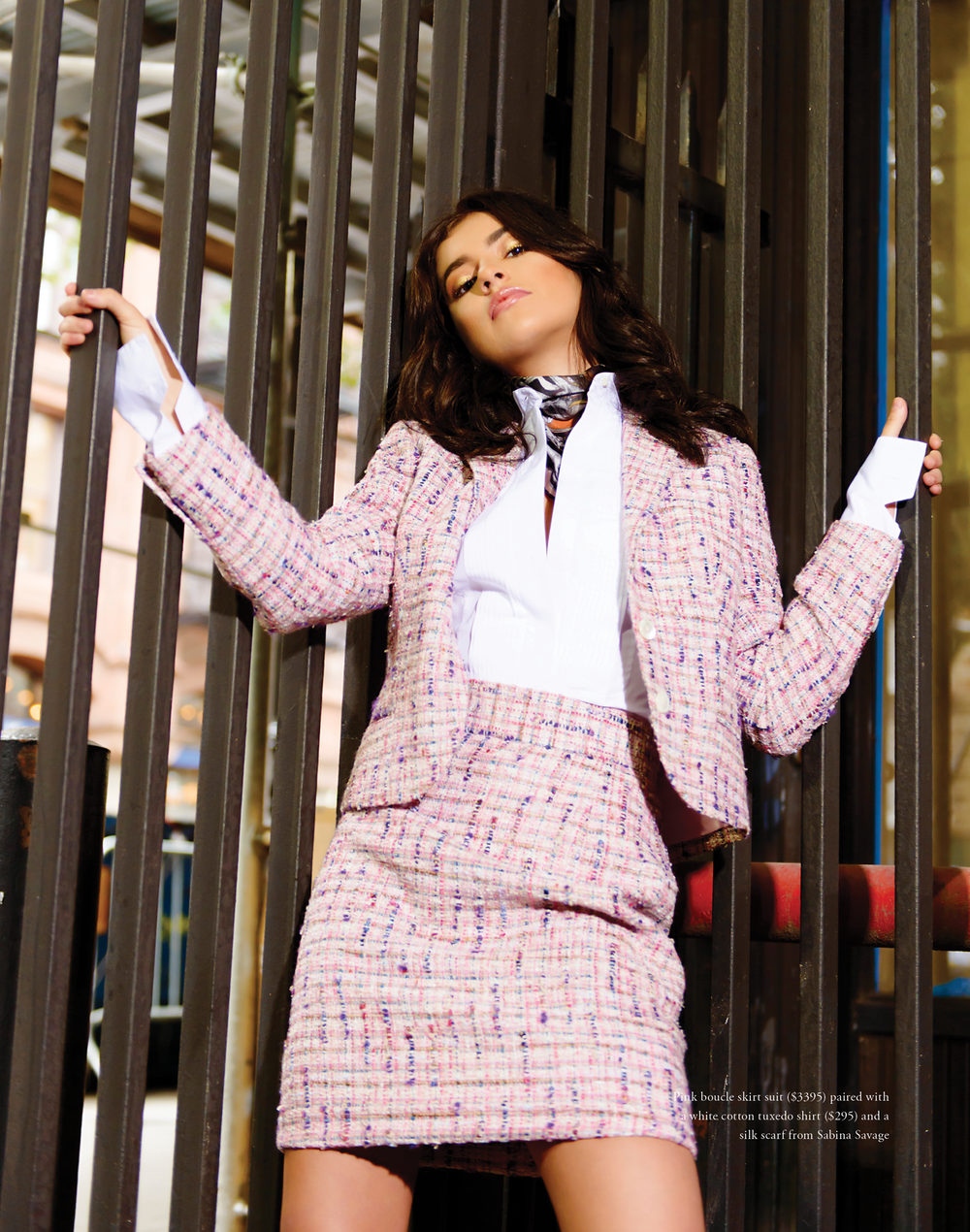 Pink boucle skirt suit ($3395) paired with a white cotton tuxedo shirt ($295) and a silk scarf from Sabina Savage