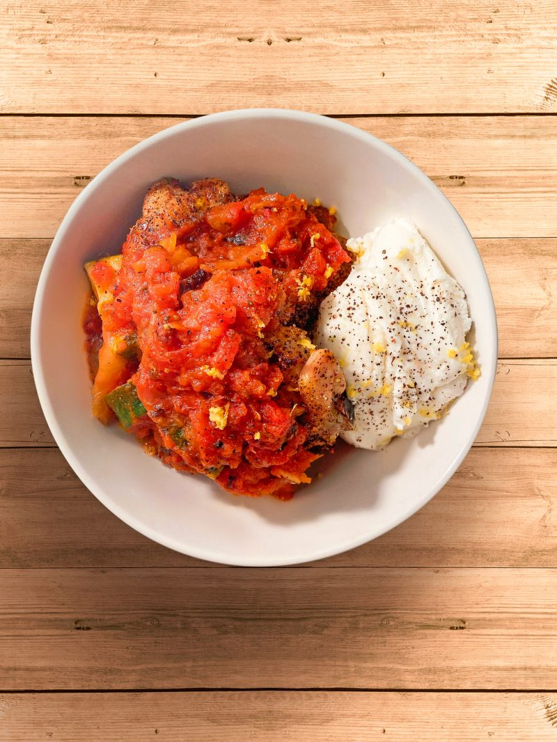 Oven-baked chicken with zucchini & caramelized onion tomato sauce